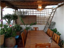 Dar Kamal Chaoui – the rooftop terrace with a dining area