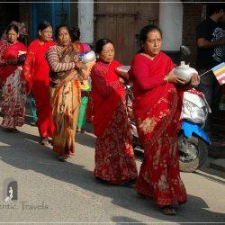 Patan: women dressed in red going to the inauguration of the Itiraz Mahavihar-n Monastery