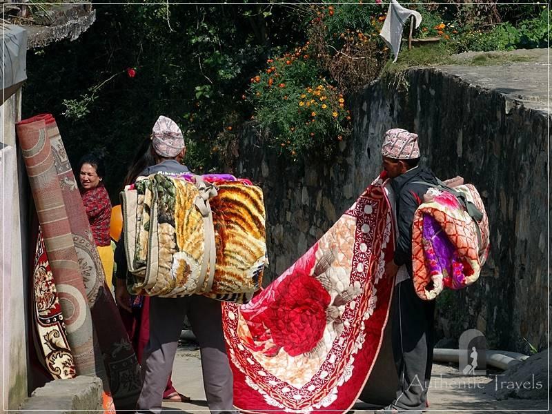 Kathmandu Valley: Chobar - men selling blankets