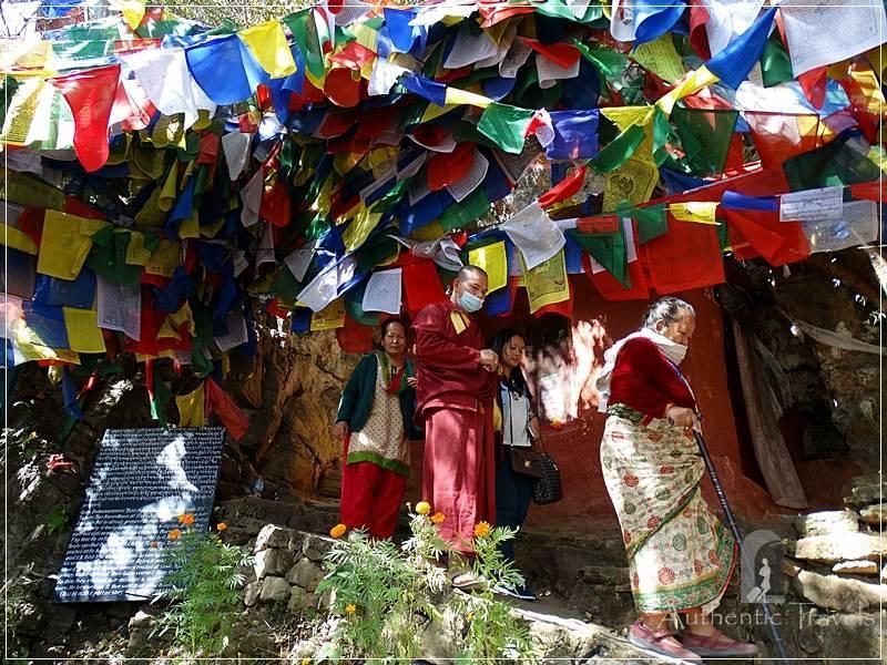 Kathmandu Valley: Pharping - Nepalis coming from Guru Rinpoche's Cave