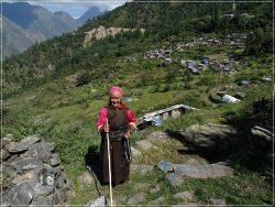 Tamang Heritage Trail - Day 6: Tamang woman reciting mantras near Briddhim village