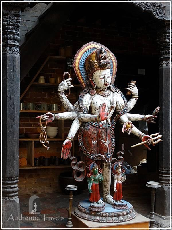 Kathmandu Valley: Bhaktapur - Tachupal Tole - a colorful wooden deity