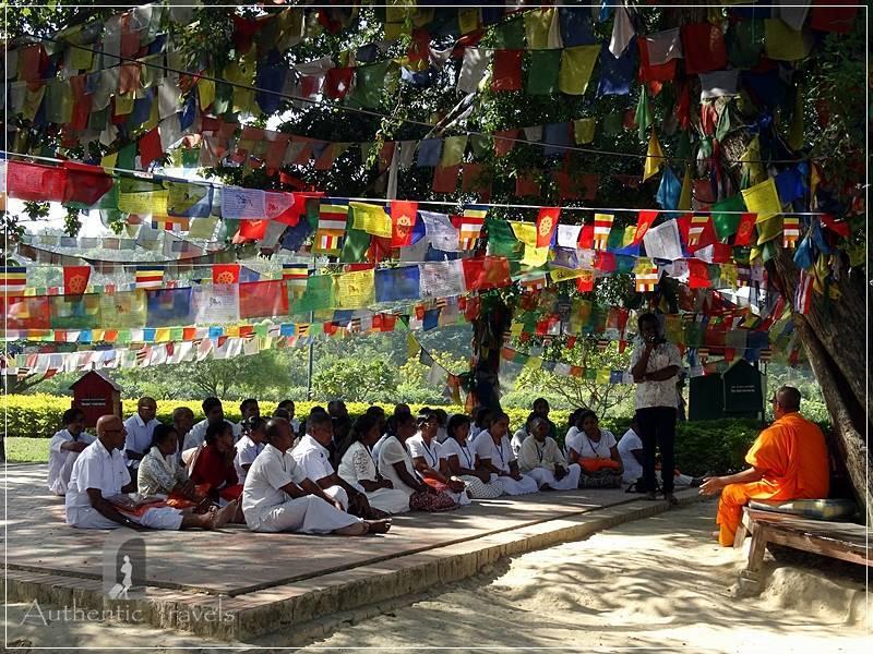 Lumbini: Maha Devi Temple - pilgrims listening to the lama
