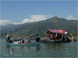 Pokhara: crossing the Phewa Lake with the Himalayas in the background