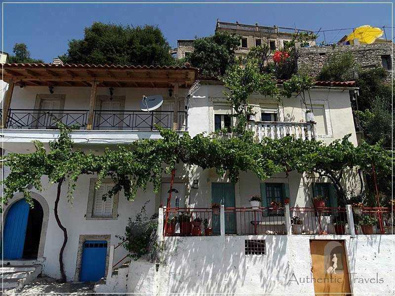 Vuno Village - whitewashed houses with greenery and balconies overlooking the sea